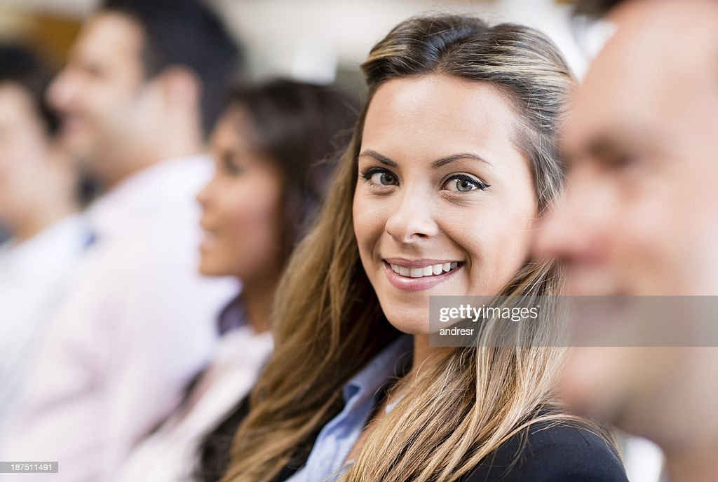 Business woman with a group : Stock Photo