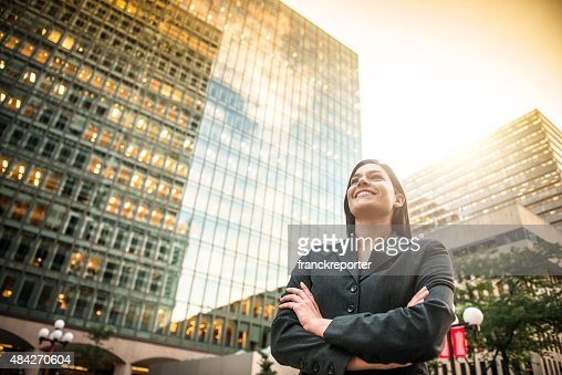 business woman with arm crossed in front of a buiding