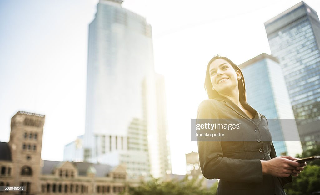 business woman with arm crossed on urban scene : Stock Photo