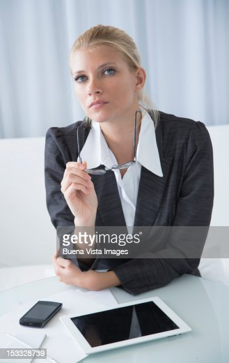 Business woman with cell phone and tablet : Stock Photo