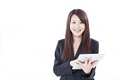 Young Asian business woman holding digital tablet isolated on white background