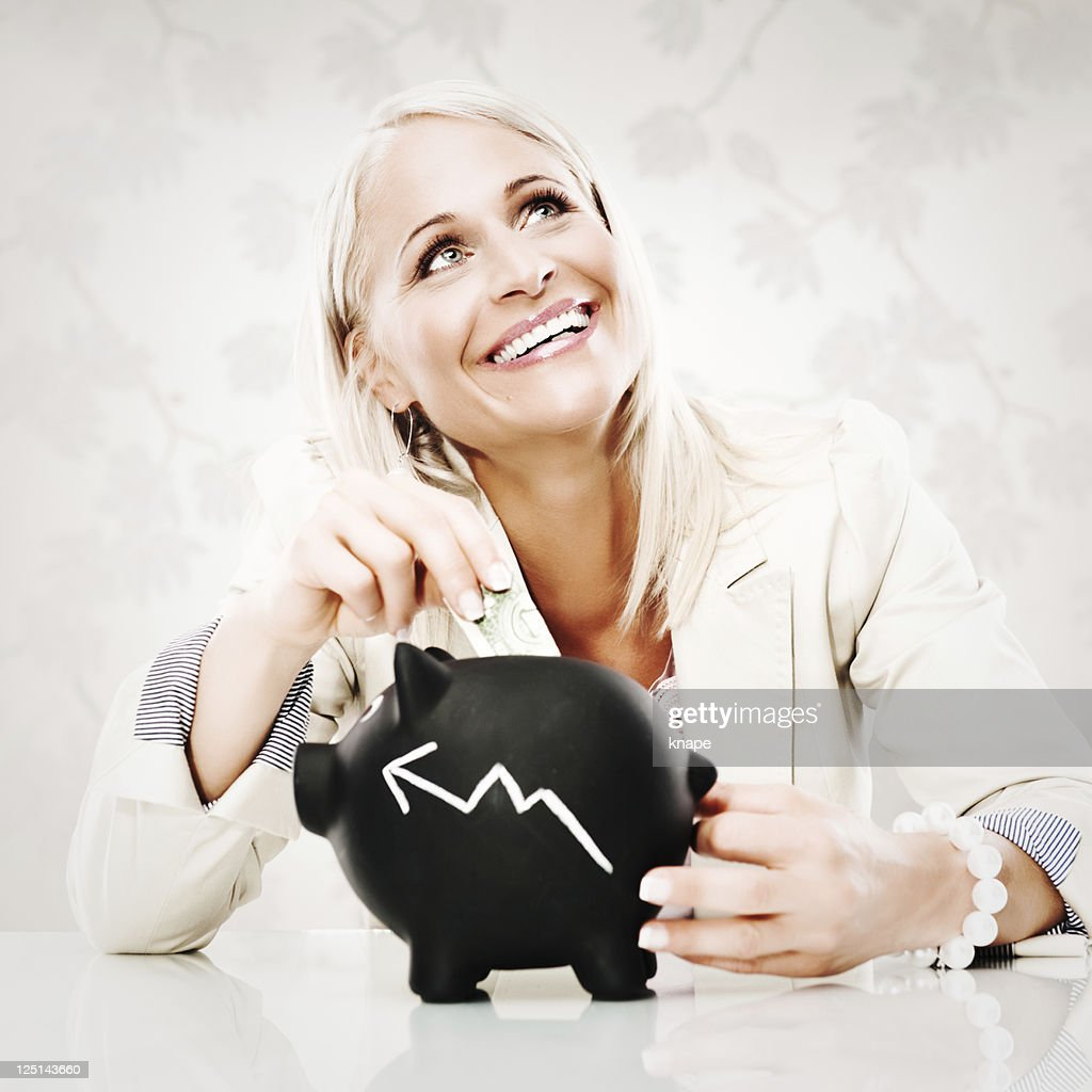 Business woman with piggy bank : Stock Photo