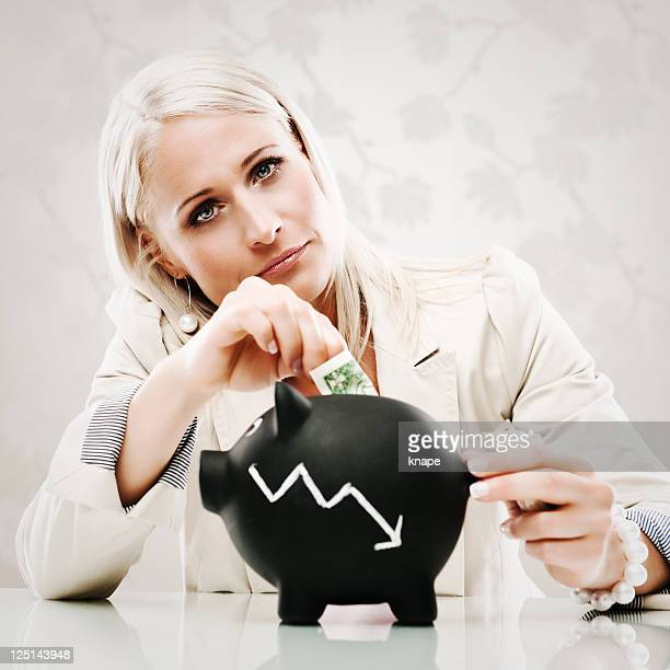 Business woman with piggy bank