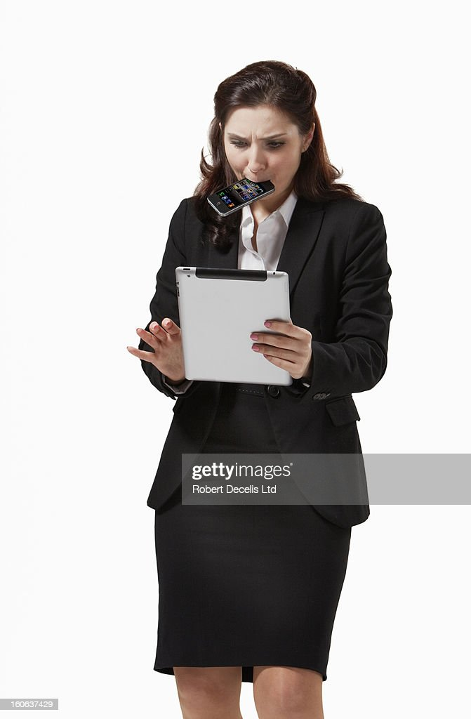 Business woman with tablet and phone : Stock Photo
