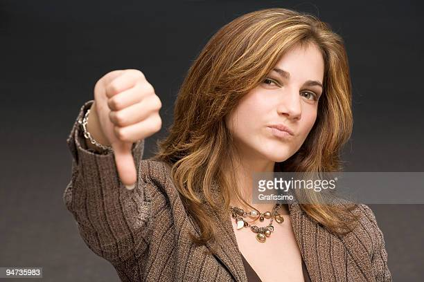 Business woman with thumbs down
