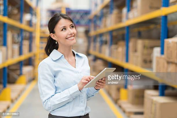Business woman working at a warehouse