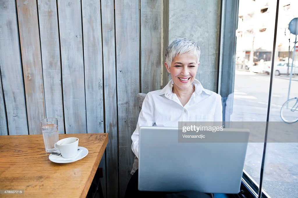 Business woman working at cafe : Stock Photo
