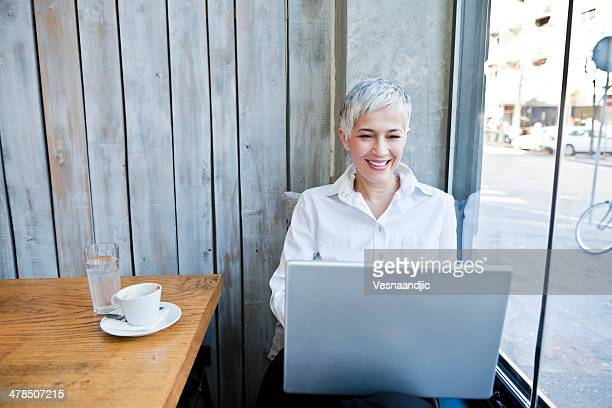 Business woman working at cafe