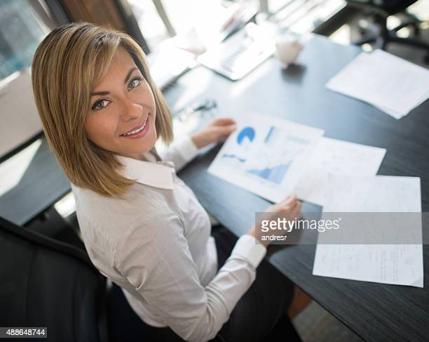 Business woman working at her office