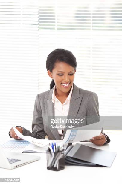 Business woman working at office.