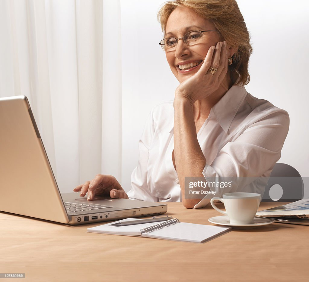 Business woman working from home : Stock Photo