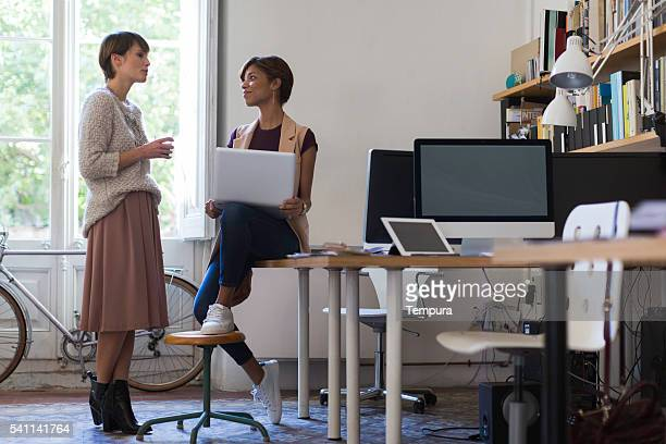 Business woman working in small  office, Barcelona.