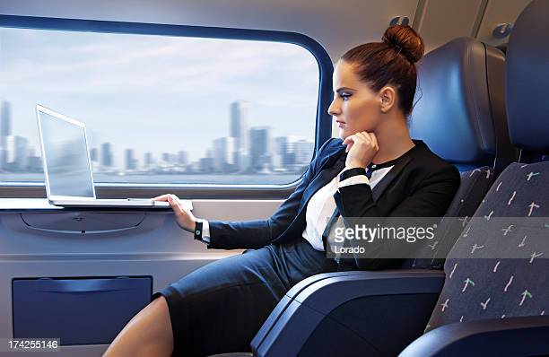 business woman working in the train