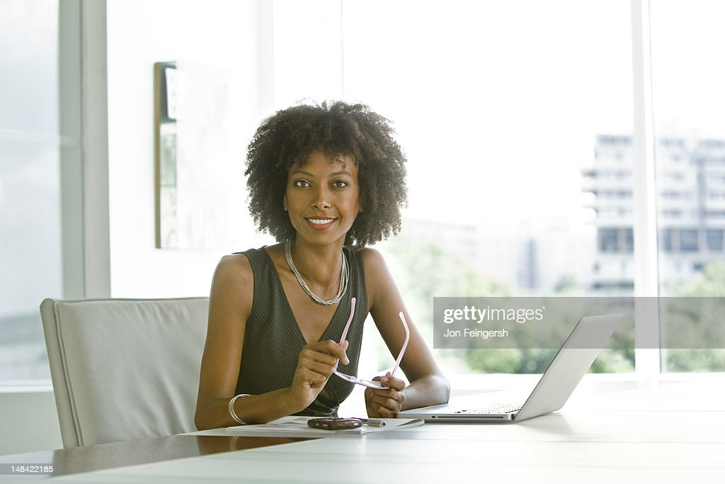 Business woman working on laptop : Stock Photo