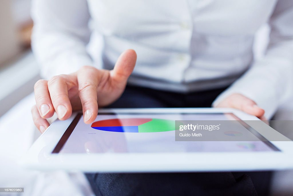 Business woman working on smart device. : Stock Photo