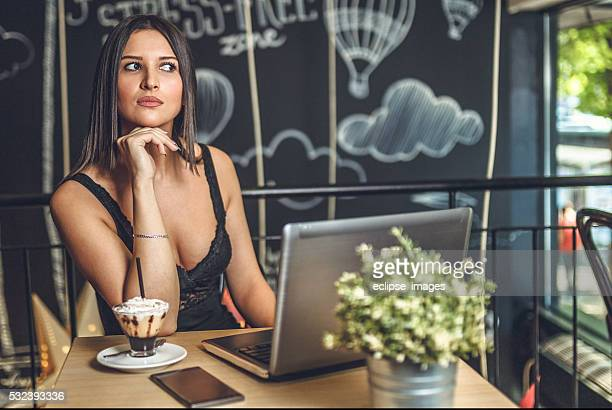 Business woman works at cafe.