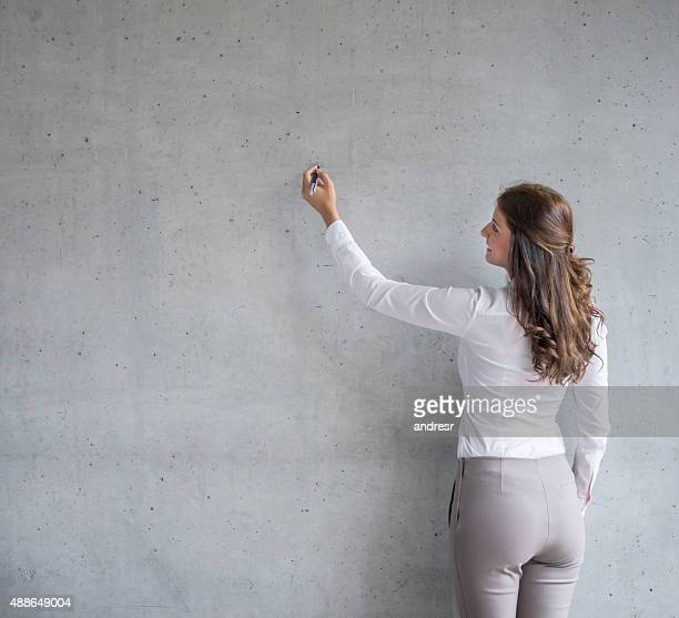 Business woman writing on a board