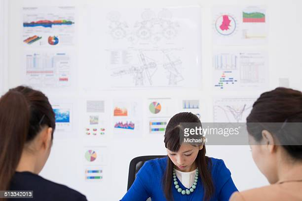 Business women at a table having a meeting