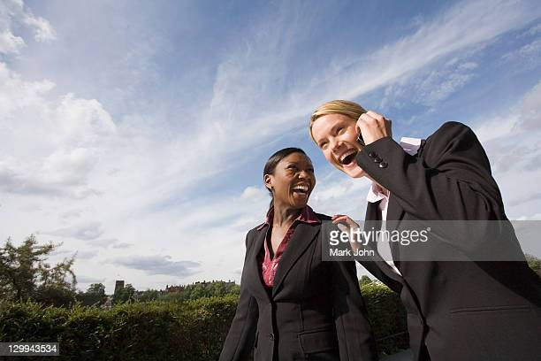 Business women laughing outdoors