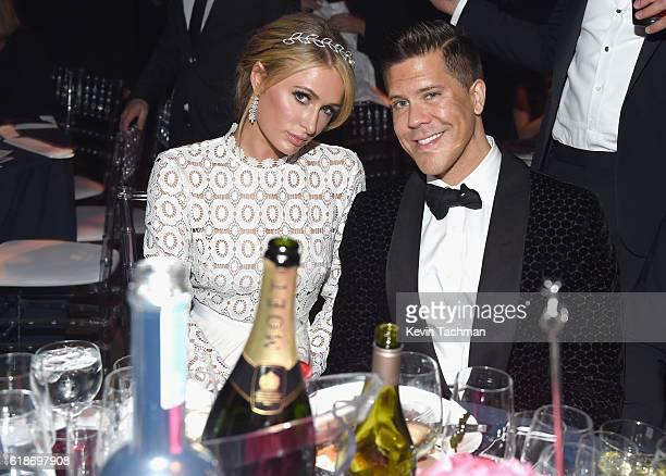 Business women Paris Hilton and TV personality/real estate broker Fredrik Eklund attend amfAR's Inspiration Gala at Milk Studios on October 27 2016...