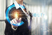 Business women touching the responsibility screen