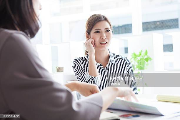Business women who express their opinions during the meeting