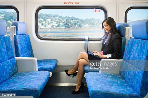 Business Women Working On A Train