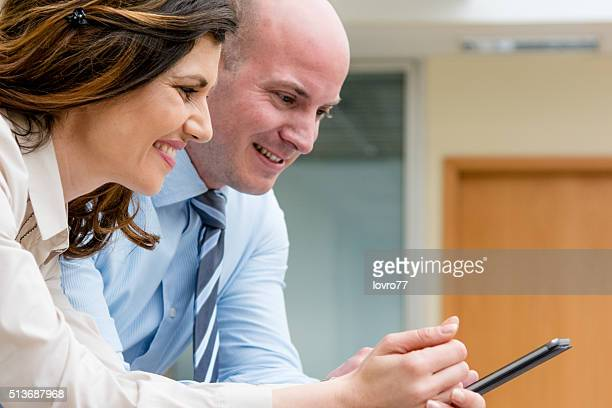 Business workers watching mobile phone