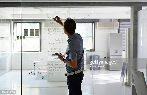 Business writing strategy on glass wall