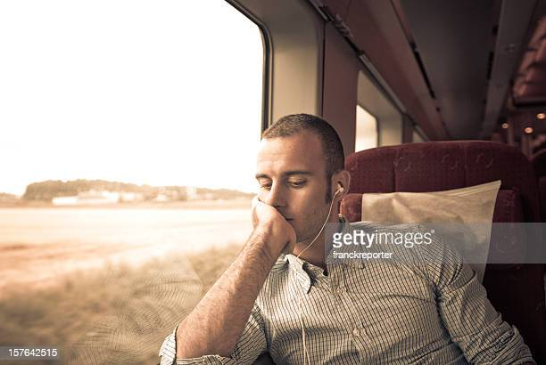 Business young Man thoughtful inside first class Train