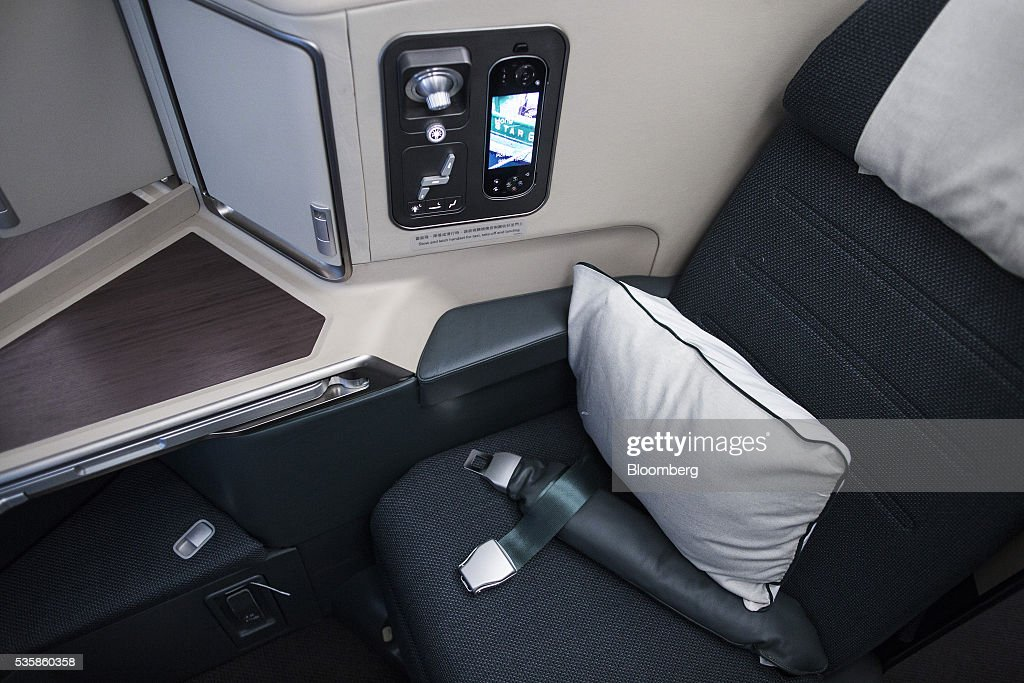 A business-class seat is seen onboard an Airbus Group SE A350-900 aircraft operated by Cathay Pacific Ltd. during a media event in Hong Kong, China, on Monday, May 30, 2016. Airbus stuck to plans to increase plane deliveries this year as it pushes to overcome a series of problems affecting production of its newest aircraft. Photographer: Justin Chin/Bloomberg via Getty Images