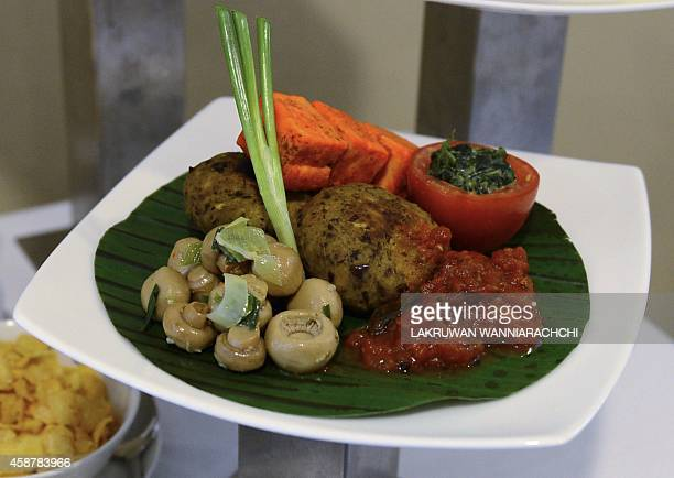 A businessclass vegetarian meal served aboard SriLankan Airlines longhaul flights is pictured at the airport in Colombo on November 10 2014 AFP PHOTO...