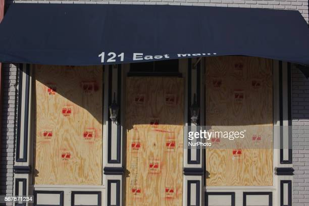 Businesses board up their windows in a fear of rioting white supremacists in Shelbyville Tennessee Illinois US on 28 Ocotber 2017