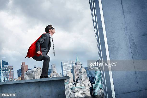 Businessman About To Leap Tall Buildings