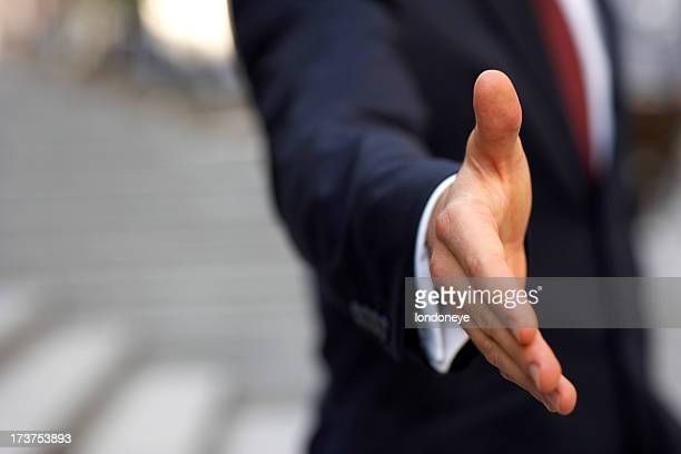 Businessman about to shake hands