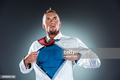 businessman acting like a super hero and tearing his shirt : Bildbanksbilder