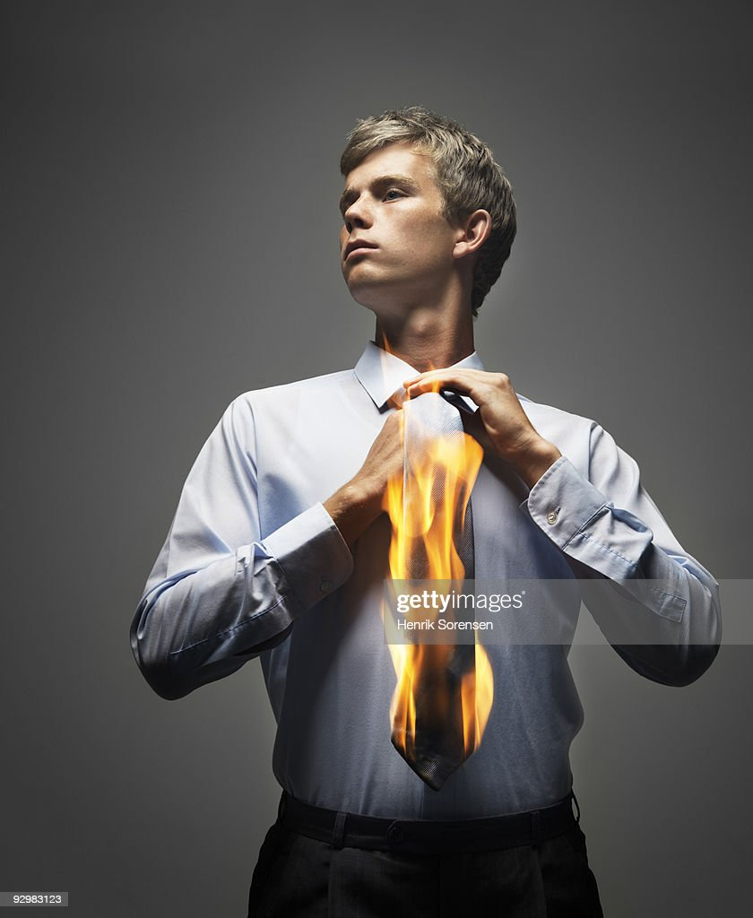 Businessman adjusting flaming tie