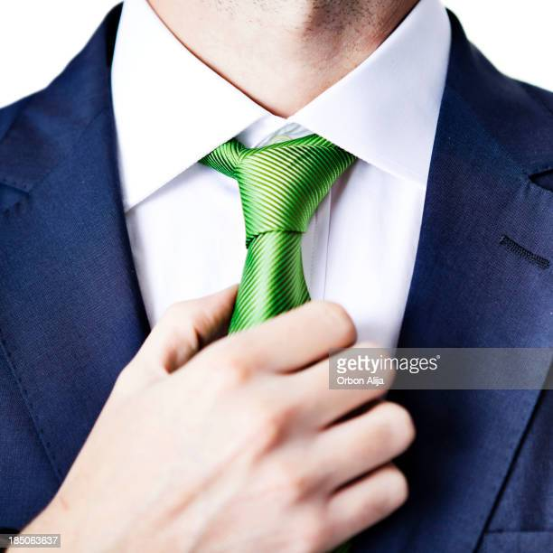 Businessman adjusting tie