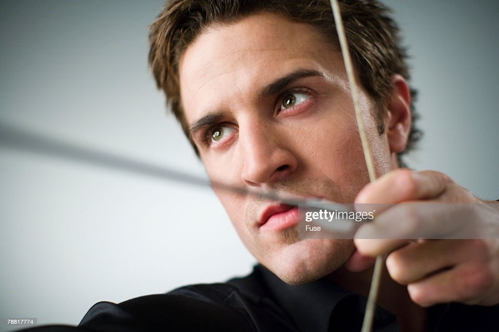 Businessman Aiming an Arrow : Stock Photo