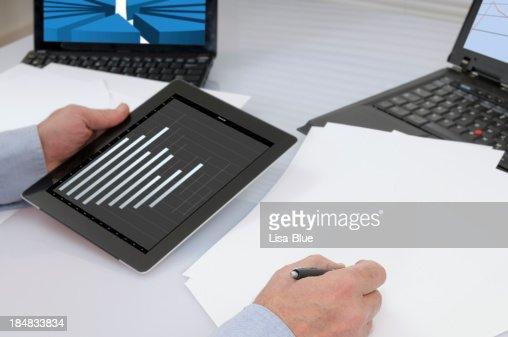 Businessman Analysing Graph on Digital Tablet PC : Stock Photo
