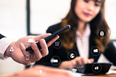young businessman analyze financial chart in smartphone . business team working with startup project. man & woman discussing market plan report at workplace. discussion, teamwork with internet of thin