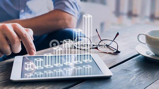 Businessman analyzing growing 3D AR chart above tablet computer screen : Stock Photo