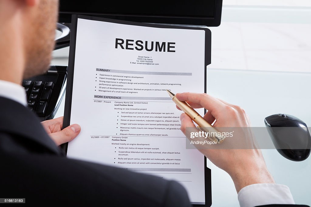 businessman analyzing resume at office desk stock photo getty images