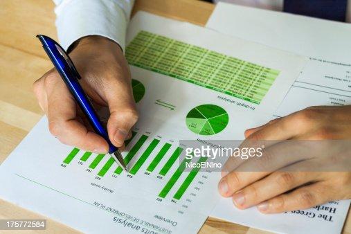 Businessman analyzing sustainable development chart : Stock Photo