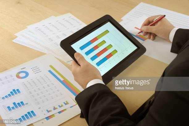 Businessman analyzing with tablet pc