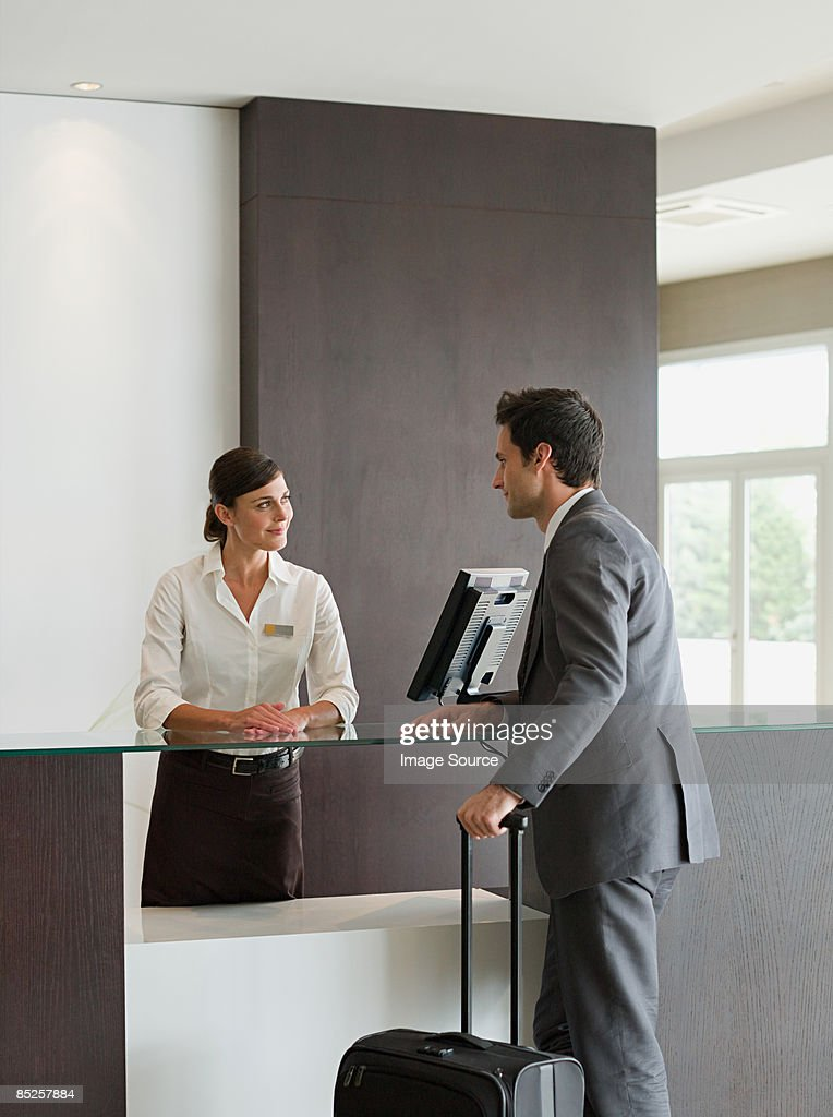 A businessman and a receptionist