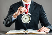 Businessman and alarm clock,studio shooting