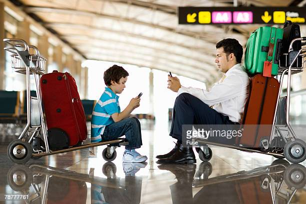 Businessman and Boy at the Airport