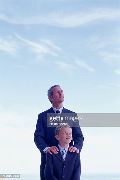 Businessman and boy wearing suit