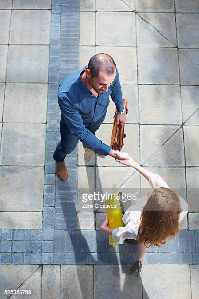 Businessman and business woman shaking hands